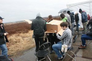 Cardboard box used as a rain protection. (One of the teams which had their CanSat in the third rocket.)
